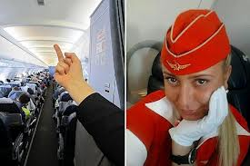 Flight attendant Tatiana Kozlenko who posted a picture of herself giving her passengers the finger has been sacked by Aeroflot airline photo