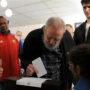 Fidel Castro in rare public appearance voting in Cuba's parliamentary elections