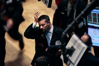Global stock markets have fallen after some members of the Federal Reserve suggested its stimulus measures may be increasing the risks of future economic and financial imbalances photo