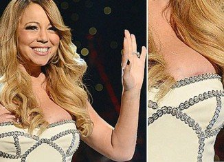 Mariah Carey was presenting the So So Def 20th Anniversary Concert in Atlanta over the weekend in a strapless dress, helping celebrate with pal Jermaine Dupree