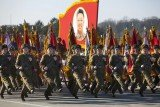 "North Korea has commemorated late leader Kim Jong-il's 70th birthday with a military parade, pledges of loyalty to his son, Kim Jong-un, and thousands of red ""kimjongilia"" begonias"