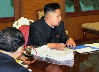 North Korean leader Kim Jong-un has been photographed with a smartphone beside him during a meeting