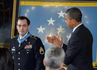 President Barack Obama has presented the Medal of Honor to former Staff Sgt Clinton Romesha for his heroism during a huge firefight in Afghanistan