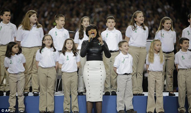 sandy hook choir sing at super bowl The video, uploaded to thelogicbeforeauthority channel on youtube, looks to have discovered at least some of the alleged victims, out of the 20 children that were supposed to have been killed inside the school on december 14, 2012, still alive and singing with the sandy hook choir at the super bowl a.