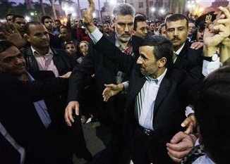 Security guards have seized a man who tried to hit Iran's President Mahmoud Ahmadinejad with a shoe as he visited a mosque in the Egyptian capital Cairo
