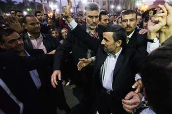 Security guards have seized a man who tried to hit Iran's President Mahmoud Ahmadinejad with a shoe as he visited a mosque in the Egyptian capital Cairo photo