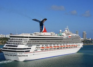Stranded Carnival Triumph cruise ship with more than 4,000 people aboard is within sight of land four days after an engine fire knocked out the vessel's power
