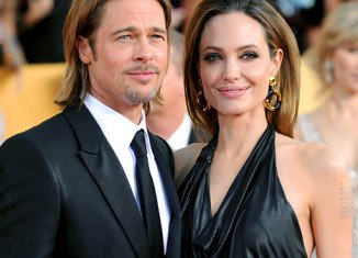 The National Enquirer claims Angelina Jolie told an astonished Brad Pitt that her former flame, Colin Farrell, put him to shame between the sheets