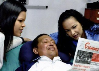 Venezuela's President Hugo Chavez is still suffering breathing problems after returning from Cuba where he was treated for cancer