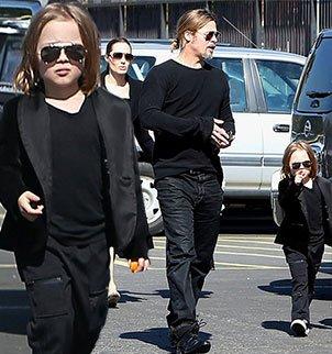 With golden shoulder length hair, a sophisticated black suit and aviator sunglasses, Knox Jolie-Pitt appears to be the spitting image of his famous father, Brad Pitt