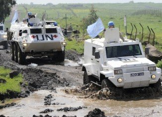 About 20 UN observers have been detained by about 30 armed fighters in the Golan Heights on the Syria-Israel border