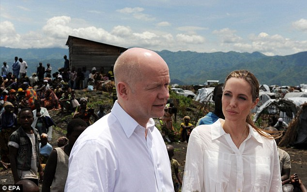 Angelina Jolie was spotted without her engagement ring as she arrived in the Democratic Republic of Congo and Rwanda with British Foreign Secretary William Hague