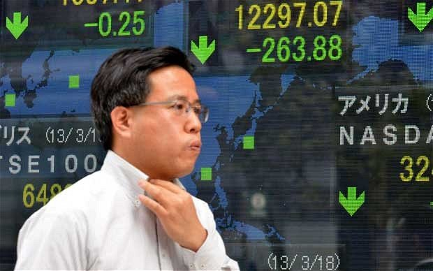 Asian shares fall on fears that the plan to bailout Cyprus could trigger an escalation of the eurozone debt crisis