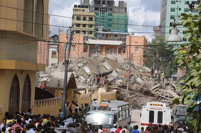 At least three people have been killed and dozens more are trapped after a multi-storey building collapsed in Dar es Salaam