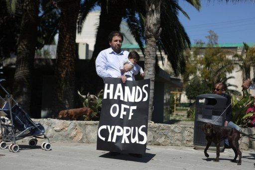 Cyprus parliament has rejected the controversial levy on bank deposits photo