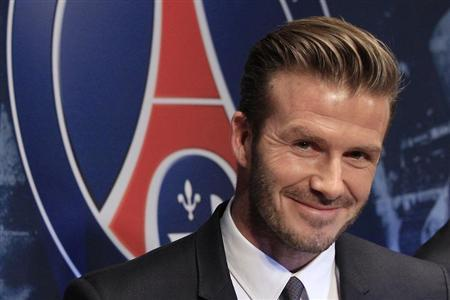 David Beckham's new role will involve attending league matches in China and visiting clubs to help promote football to children photo