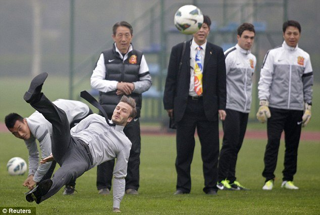 David Beckham slipped over and landed on his backside in front of a group of young Chinese footballers while demonstrating his free kick technique
