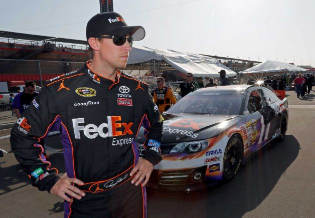 Denny Hamlin remains hospitalized overnight after being airlifted to a local hospital after a hard single car crash at the inside wall on the final lap of Sundays Auto Club 400 photo