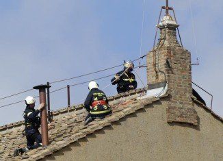 Firefighters have fitted a chimney on top of the Sistine Chapel in the Vatican ahead of the conclave which will elect a new pope
