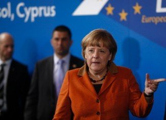 German Chancellor Angela Merkel warned Cyprus not to exhaust the patience of its eurozone partners