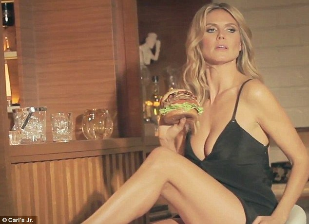Heidi Klum's commercial for Carls Jr.'s Jim Beam Bourbon Burger is probably the hottest in the history of fast food commercials photo