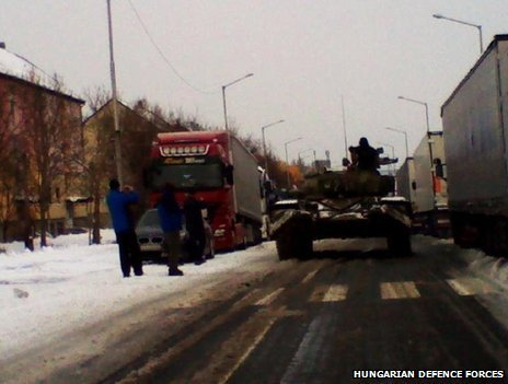 Hungary has deployed tanks to reach snowbound motorists as cold weather causes transport chaos across Eastern Europe photo