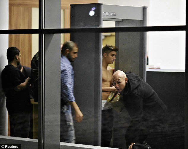 Justin Bieber was seen once again going shirtless as he stepped through a security gate at Wladyslaw Reymont Airport in Lodz Poland photo