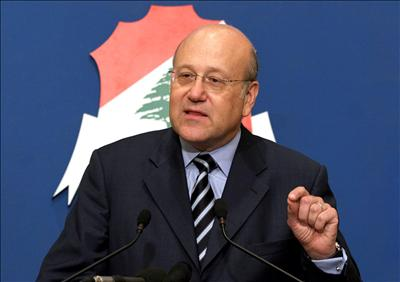 Lebanon's PM Najib Mikati has announced the resignation of his entire cabinet photo