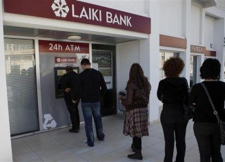 Many Cypriots, shocked that the bailout imposes a levy on bank deposits of up to 10 percent, were seen queuing to withdraw cash