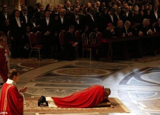 Pope Francis lying on the floor during Good Friday service in Saint Peter's Basilica at the Vatican