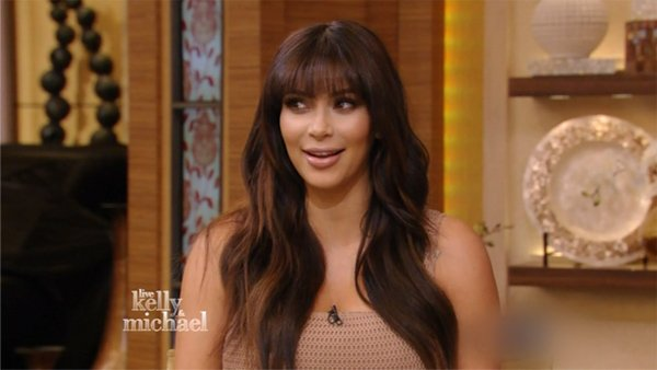 Pregnant Kim Kardashian revealed she has gained 20 lbs during an interview on Live With Kelly and Michael in New York photo