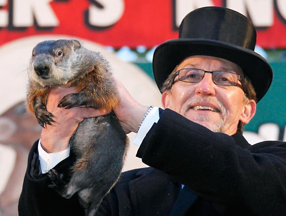 Punxsutawney Phil forecast an early spring for 2013 when he did not see his shadow as he emerged from hibernation on February 2 photo