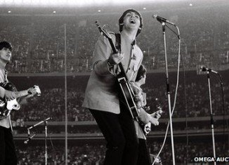 Rare pictures of The Beatles' 1965 Shea Stadium concert, taken by amateur photographer Marc Weinstein, who bluffed his way backstage, have sold for £30,000