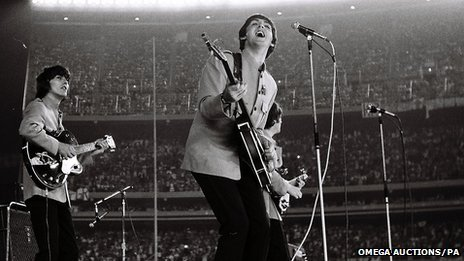 Rare pictures of The Beatles 1965 Shea Stadium concert taken by amateur photographer Marc Weinstein who bluffed his way backstage have sold for £30000 photo