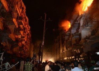 The blast in the mainly Shia Muslim area of Abbas Town destroyed several buildings and set others on fire