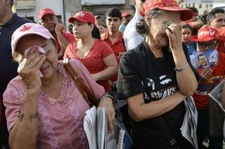 Thousands of Hugo Chavez's supporters took to the streets of Caracas to express their grief