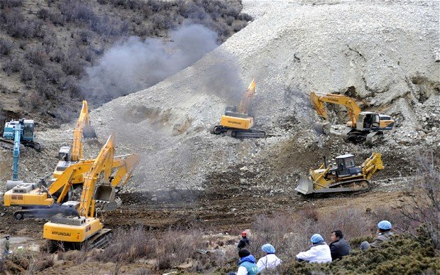 Tibetan rescue teams are searching for 83 miners buried in a landslide in Maizhokunggar county