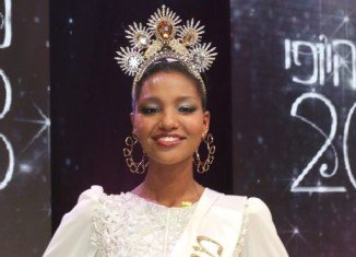 Yityish Aynaw, an immigrant orphan from Ethiopia, who became the first black Miss Israel last month, has been invited to Thursday's gala dinner with visiting President Barack Obama
