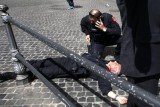 A man has been arrested in Italy after he shot two police officers outside the PM's office in Rome during new government swearing-in ceremony