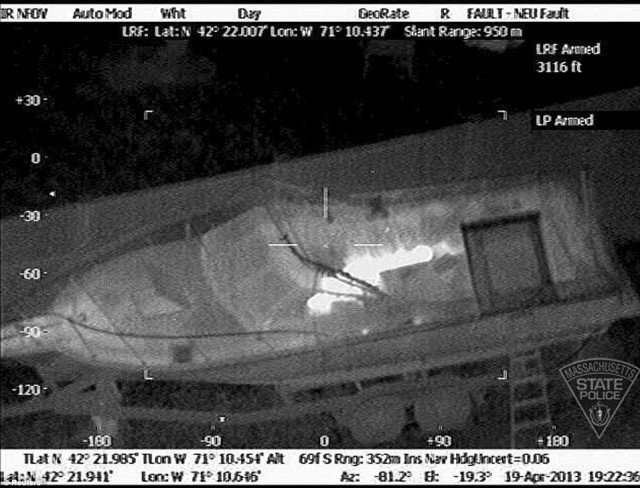 A video of Dzhokhar Tsarnaev capture shows a police robot ripping apart the tarp concealing the suspect and numerous flash bang grenades being thrown into the boat where he lay