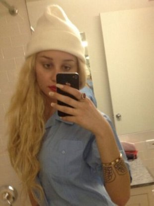 Amanda Bynes claims she shaved her head because of hair damage at John Barrett