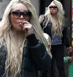 Amanda Bynes continued her bizarre behavior by openly smoking a suspicious-looking hand-rolled cigarette through Times Square