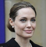 Angelina Jolie's scraped back hairdo revealed her abundance of grey hairs as she made an appearance at the G8 Foreign Ministers Summit in London