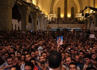 At least one person has been killed and more than 20 injured in clashes outside Cairo's St Mark's Cathedral following the funerals of four Coptic Christians killed in religious violence