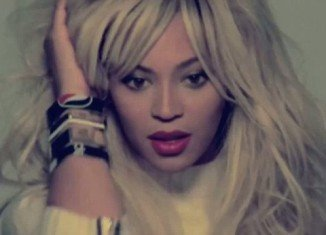 Beyoncé reveals a platinum blonde hairdo in a teaser for her new music video Grown Woman