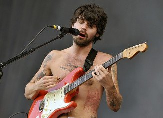 Biffy Clyro canceled their US tour dates due to Simon Neil's respiratory problems