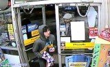 Dzhokhar Tsarnaev enters a gas station in Cambridge, Massachusetts, wearing a gray hoodie and carrying snacks on Thursday evening