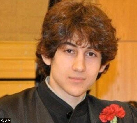 "Dzhokhar Tsarnaev is ""clinging to life"" under armed guard in the same hospital where 11 of Boston Marathon bombings victims are still being treated"