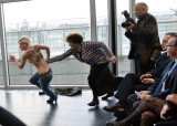 FEMEN activists stormed a conference attended by Tunisian President Moncef Marzouki in Paris