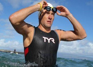 Former cyclist Lance Armstrong is planning to return to competitive sport as a swimmer